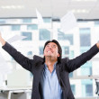 Excited businessman throwing papers Excited businessman throwing papers — Stock Photo