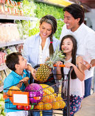 Happy family at the supermarket Happy family at the supermarket — Stock Photo