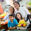 Stock Photo: Family paying at supermarket Family paying at supermarket