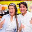 Stock Photo: Couple with thumbs up Couple with thumbs up