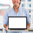 Business man with a laptop Business man with a laptop - Stock Photo
