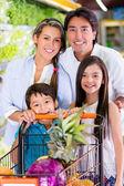 Happy family at the supermarket Happy family at the supermarket — Stock Photo