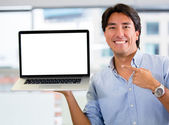 Businessman holding a computer Businessman holding a computer — Stock Photo