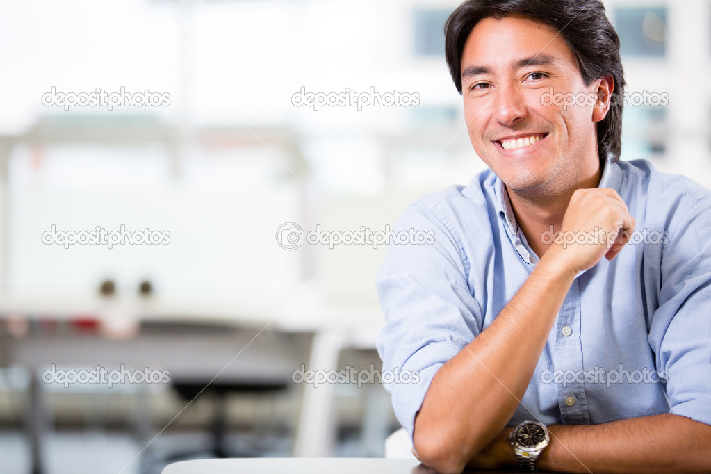 Handsome business man at the office smiling Handsome business man at the office smiling  — Stock Photo #19908437