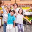 Excited family at a cafeteria Excited family at a cafeteria — Stock Photo #19910665