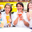 Happy family at a cafeteria Happy family at a cafeteria — Stock Photo
