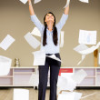Successful businesswoman throwing papers Successful businesswoman throwing papers — Stock Photo