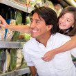 Stock Photo: Father and daughter buying groceries Father and daughter buying groceries