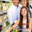 Family shopping for groceries Family shopping for groceries — Stock Photo