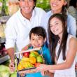 Healthy family at the local market Healthy family at the local market — Stock Photo