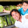 Foto de Stock  : Father and son buying groceries Father and son buying groceries