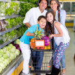 Happy family at the supermarket Happy family at the supermarket — Stock Photo #20018683