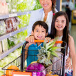 Mother shopping at the supermarket Mother shopping at the supermarket — Stock Photo
