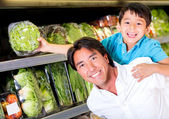 Father and son buying groceries Father and son buying groceries — Stock Photo