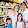Family at the supermarket Family at the supermarket - Stock Photo
