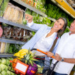 Couple at the supermarket Couple at the supermarket — Stock Photo