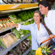 Stock Photo: Couple buying groceries Couple buying groceries