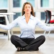 Business woman doing yoga Business woman doing yoga - Stock Photo