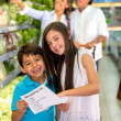 Kids with shopping list Kids with shopping list — Stock Photo
