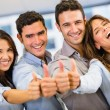Royalty-Free Stock Photo: Business group with thumbs up Business group with thumbs up
