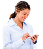 Business woman texting on her phone Business woman texting on her phone — Stock Photo