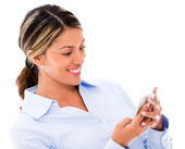 Kvinna med sin smartphone kvinna med sin smartphone — Stockfoto