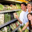 Family at the supermarket Family at the supermarket — Stock Photo