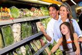 Family at the supermarket Family at the supermarket — Stock Photo