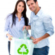 Stock Photo: Couple recycling bottles Couple recycling bottles