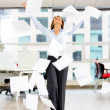Excited businesswoman throwing papers Excited businesswoman throwing papers — Stock Photo