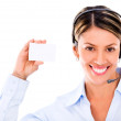 Telemarketing agent holding a card Telemarketing agent holding a card - Stock Photo