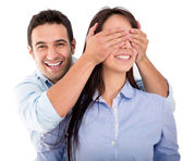 Man surprising his girlfriend Man surprising his girlfriend — Stock Photo