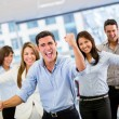 Business team celebrating a triumph Business team celebrating a triumph - Stock Photo
