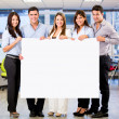 Stock Photo: Business group with a banner Business group with a banner