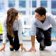 Competitive business couple Competitive business couple — Stock Photo #21219759