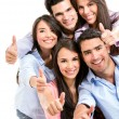 Friends with thumbs up. - Stock Photo