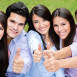 Group of friends with thumbs up. — Stock Photo