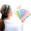 Stock Photo: Womchoosing color for wall