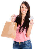 Woman shopping with credit card — Stock Photo