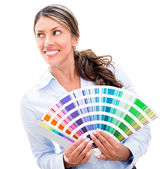 Thoughtful woman holding a color palette — Stock Photo