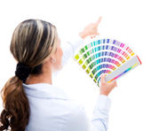 Woman choosing a color for the wall — Stock Photo