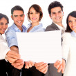 Business team holding a banner. - Stock Photo