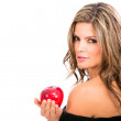 Fashion woman holding an apple. - Stock Photo