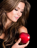 Beautiful woman holding an apple — Stock Photo