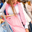 Stock Photo: Woman buying clothes