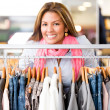 Woman buying clothes - Stock Photo