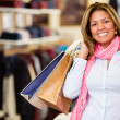 Happy woman shopping - Stock Photo