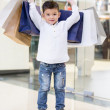 Boy holding shopping bags - Foto Stock