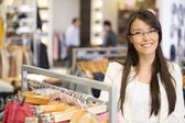 Woman at a retail store — Stock Photo