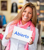 Woman with an open sign — Stock Photo